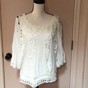 Ivory dolman sleeved crocheted top by Chico's.